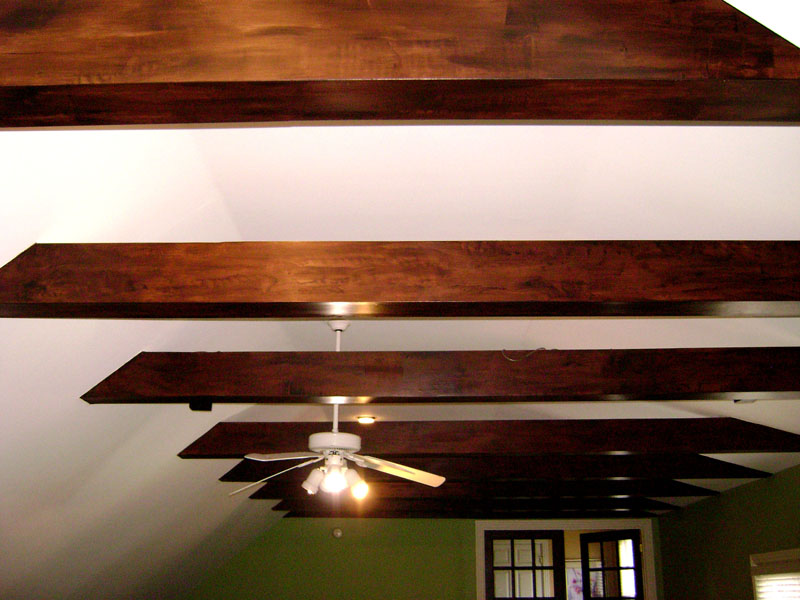 Rustic faux wood grain on false beams back