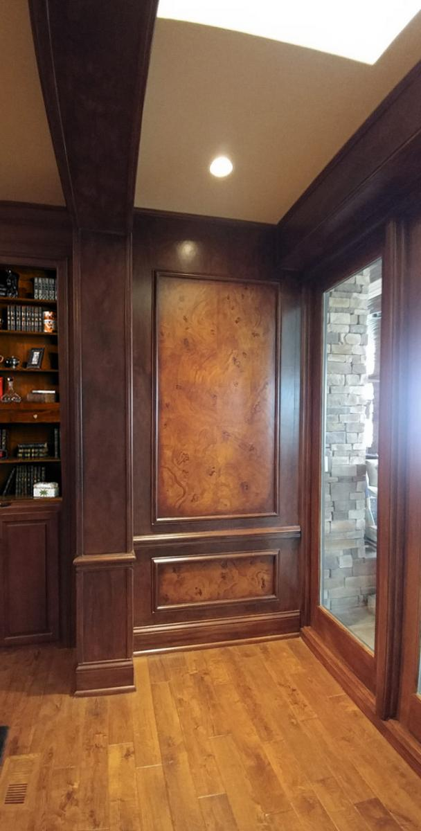 faux burl and wood grained panels and mahogany wood grained walls