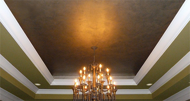Faux bronze and silver metallic master bedroom tray ceiling.