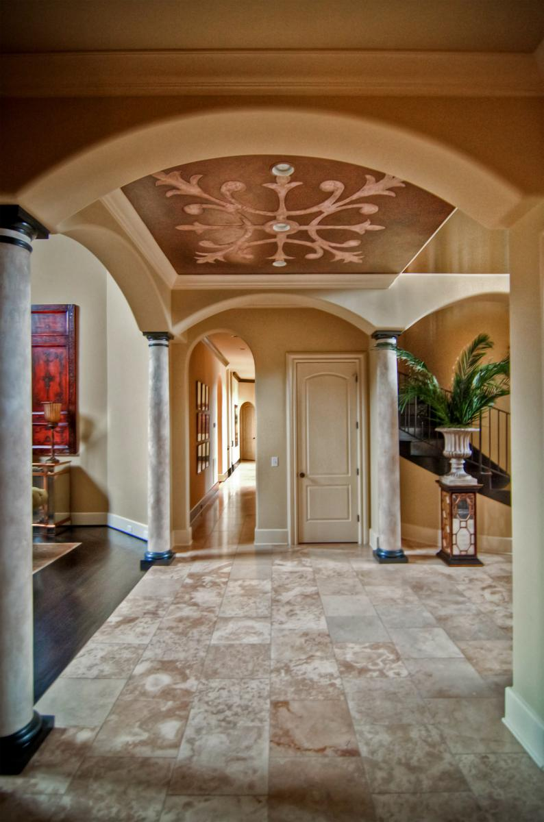 Spanish plastered columns with a custom designed plaster and metallic ceiling frieze and the right paint color for their walls was all that was needed.