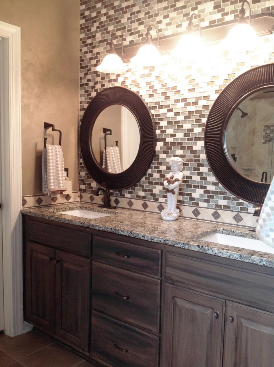 Shimmering Lusterstone walls and faux salvaged-walnut glazed vanity with blue ceiling