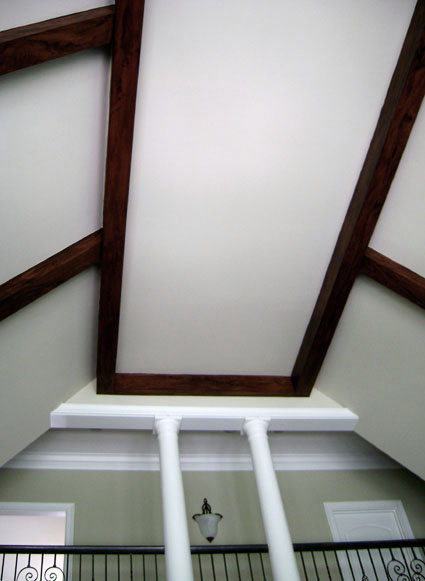 Faux wood grained false beams