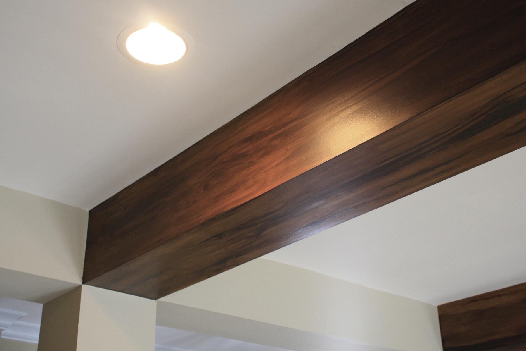 Faux wood beams in this Brentwood customers great room ceiling.
