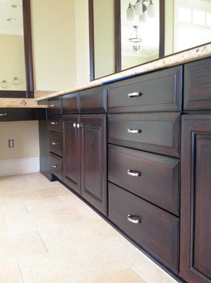 Faux mahogany wood glaze cabinet makeover for this Brentwood, TN client's Master bathroom. Beautiful!