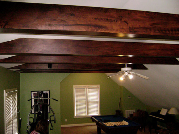 Rustic faux wood grain on false beams front