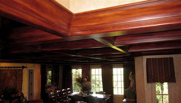 Faux wood grained coffer ceiling close-up.