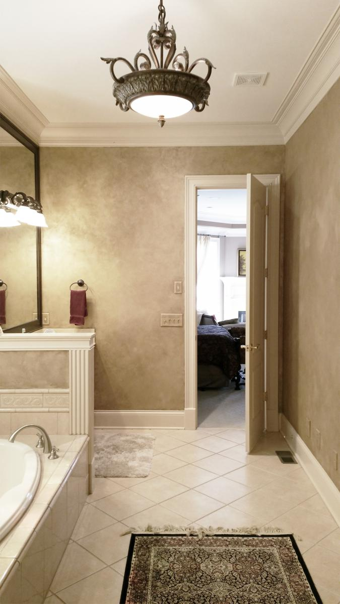 Master Bath Shimmering Lusterstone walls with custom faux designed mirror frames.