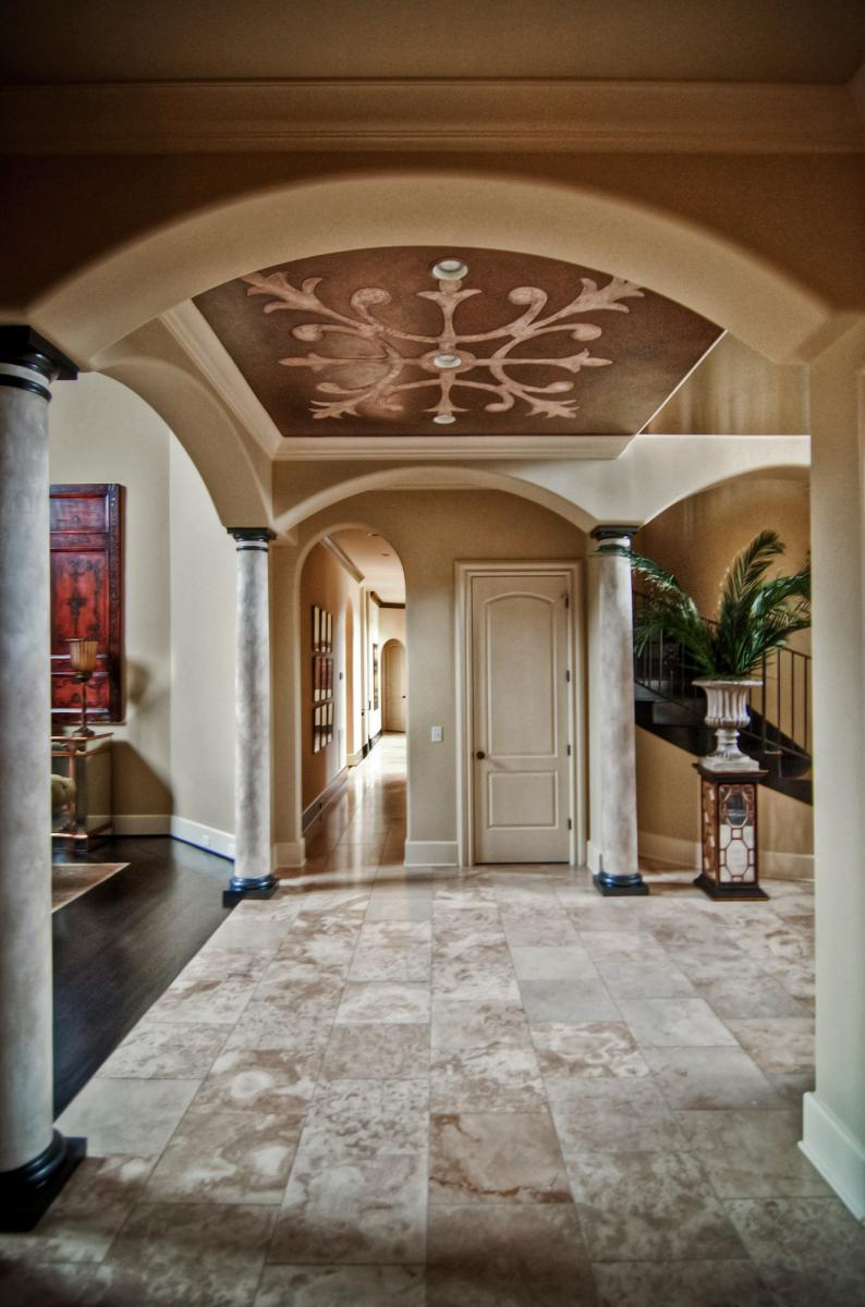 Metallic and stone ceiling design with custom-made stencil.