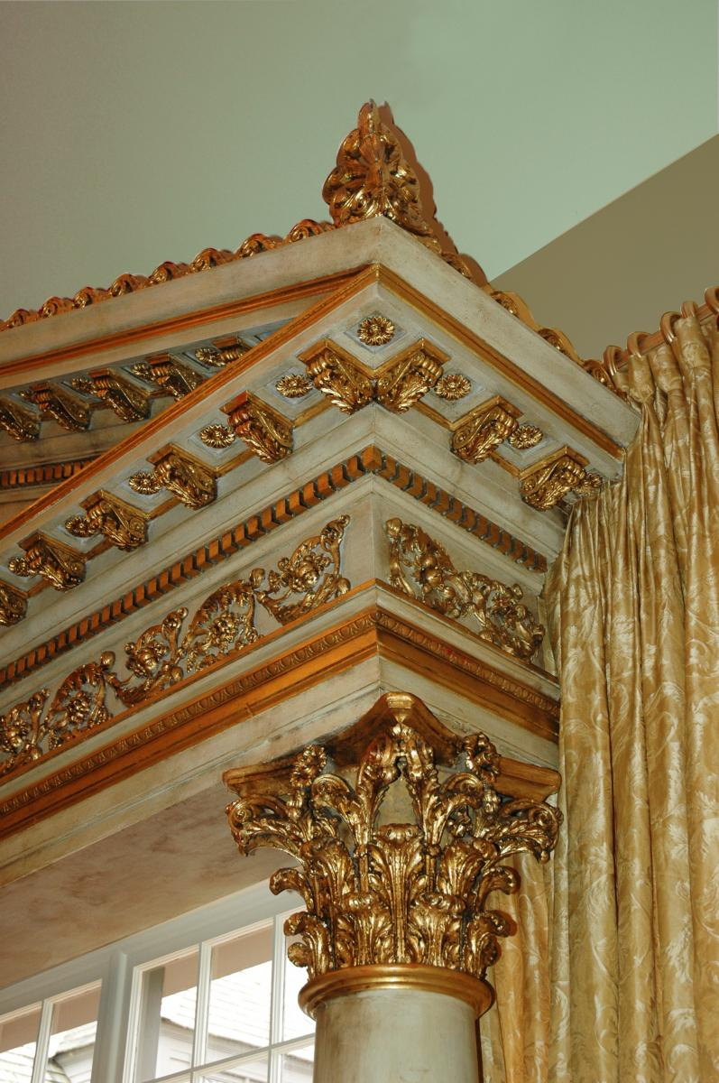 Entryway pediment adorned in 23.75 karat gold leafing and hand painted white sepia marble.