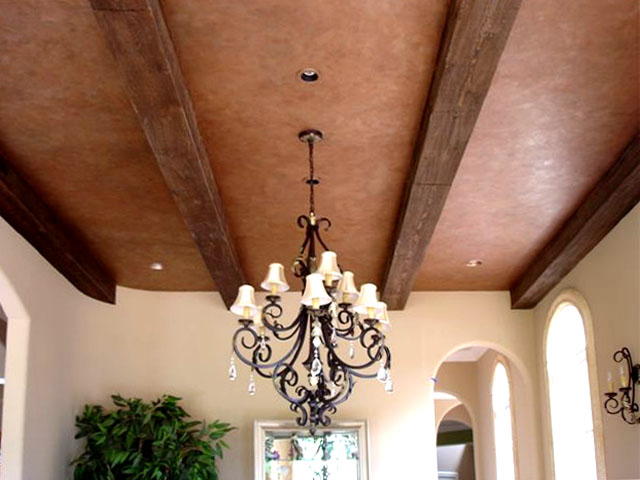 Clay colored plaster and wood grained beams.