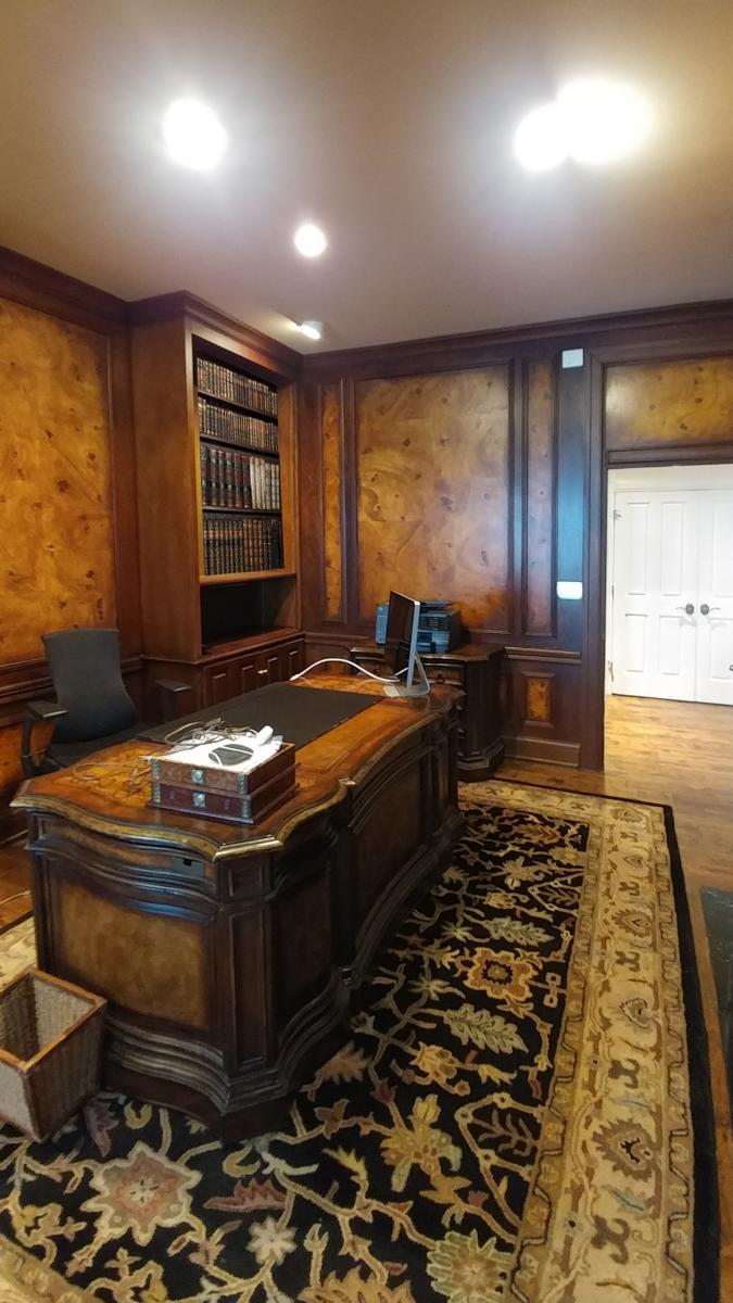 faux burl and wood grained panels and mahogany wood grained walls office view