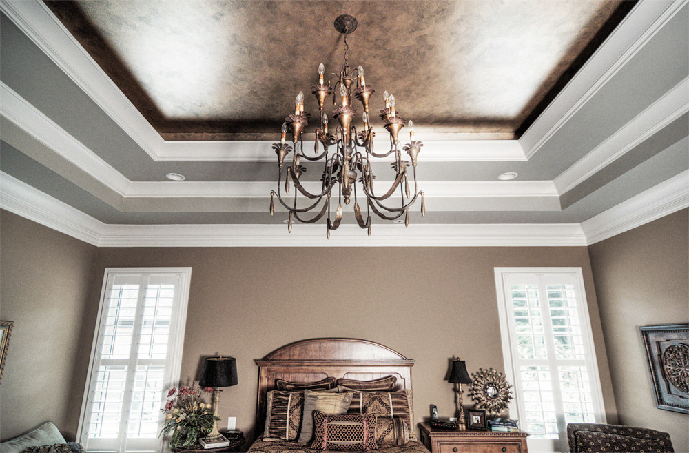 A bronze, silver and gold metallic ceiling with an accent colored tray-ceiling was the perfect combination for this Franklin, TN customer's bedroom.