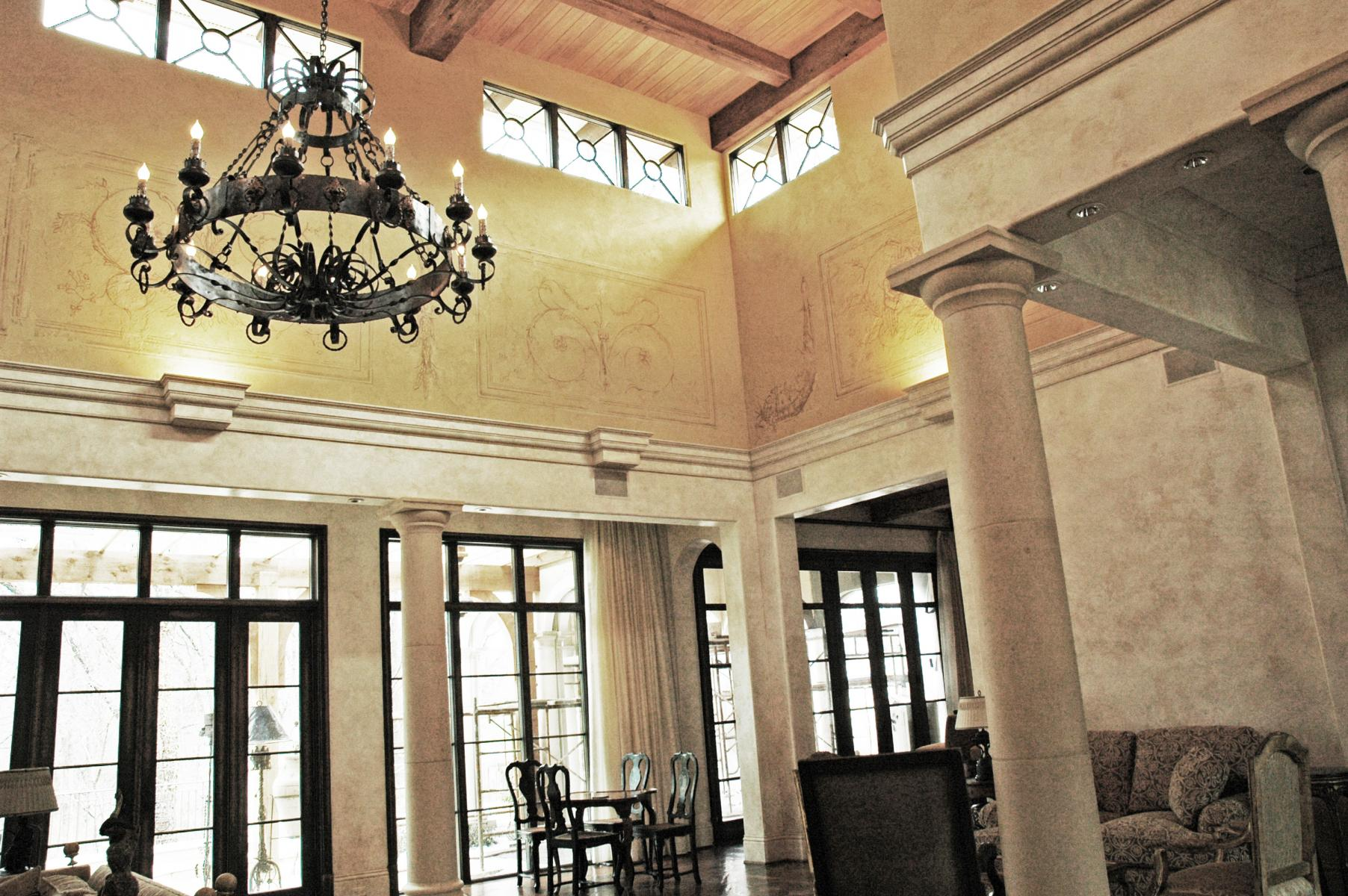 Private Client  - Faux stone glazed lower room area. Upper plaster and glaze walls showcase hand painted tone on tone trompe l'oeil fresco panels.
