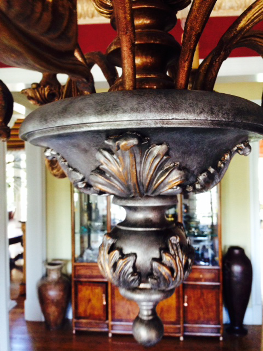 Chandelier design change - from garish gold to gilt and antique silver.