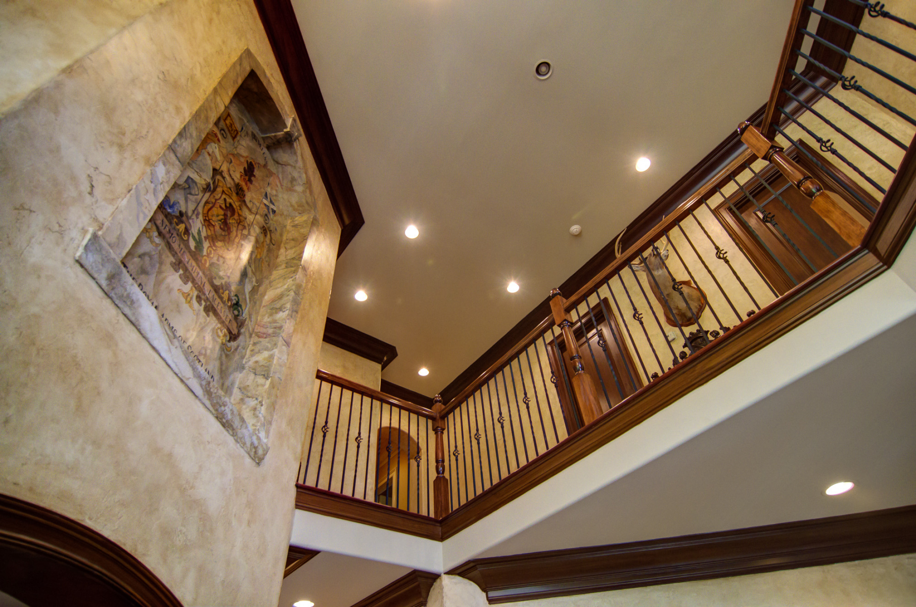 European makeover - Shot of this Brentwood customer's wood glazed trim, plaster tinted walls and 3D wall mural.