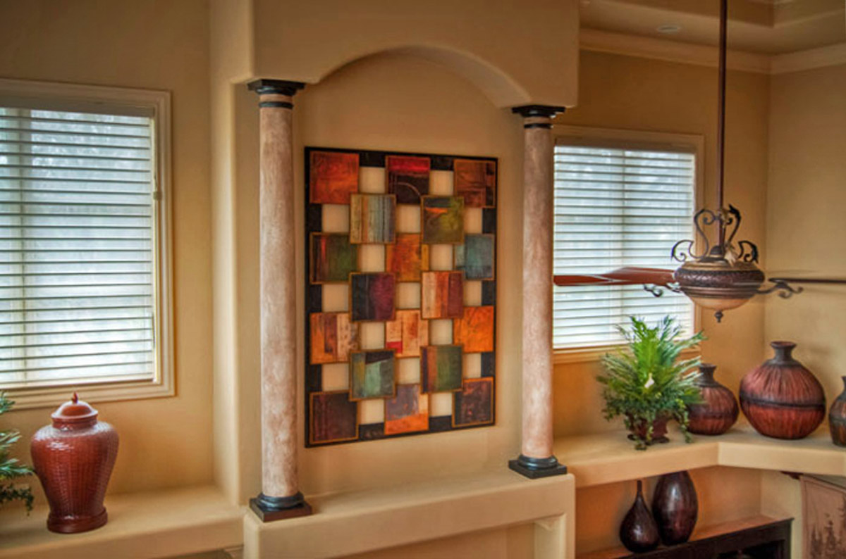 Faux stone columns and faux bronze caps and bases - it's those special touches that take good design to great design.