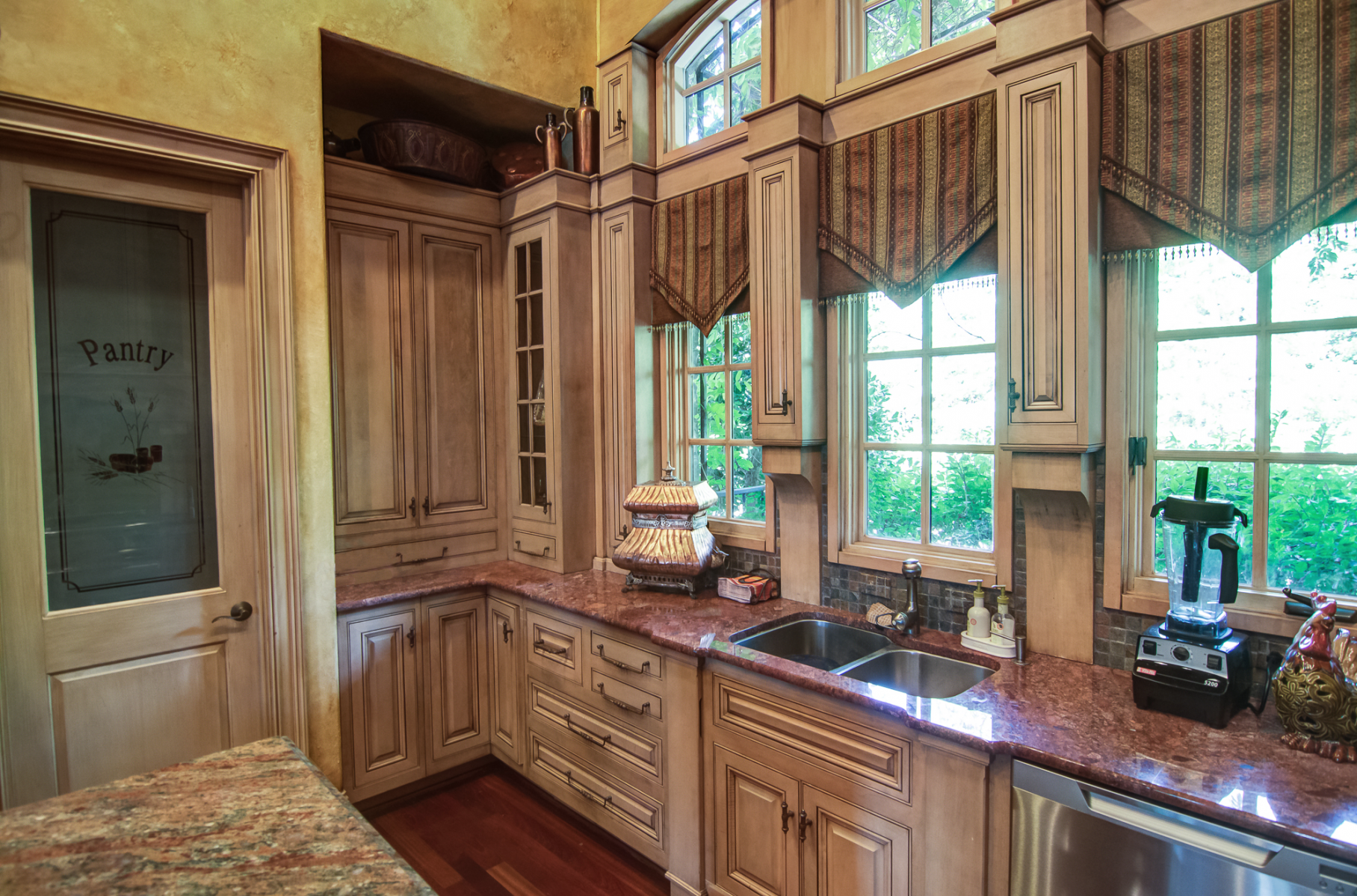 European colored plaster walls with matching cabinet glaze on wall panels.