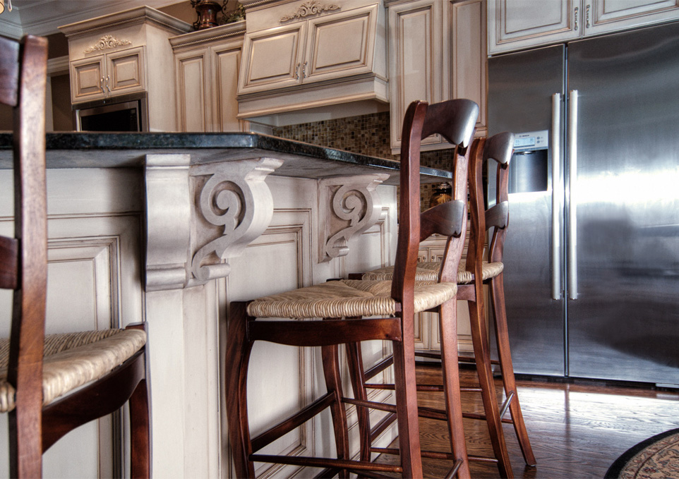 Before and After – These kitchen cabinets and breakfast bar were given a new life with modern color mixture and furniture glazing technique in Franklin, TN.