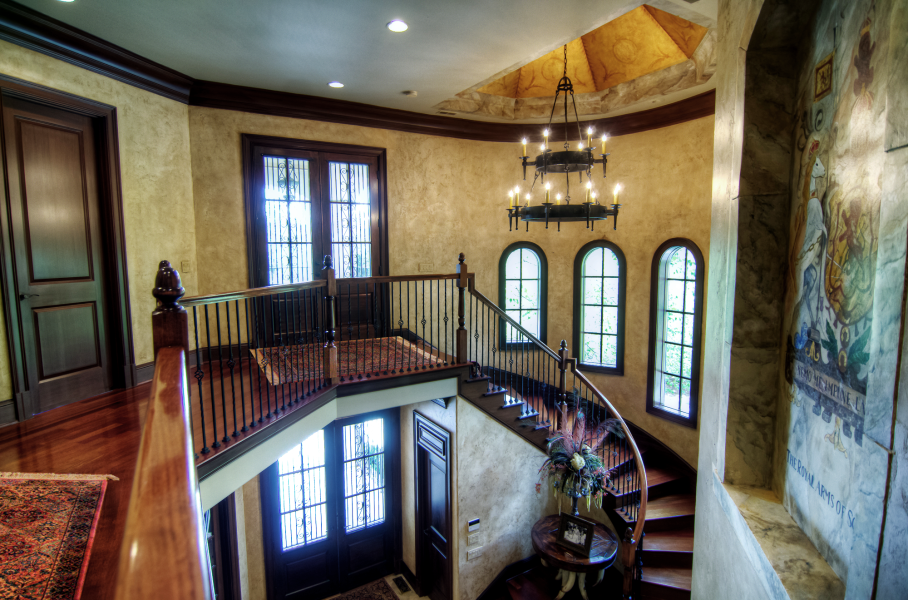 European plaster walls with wood glazed trim custom ceiling mural and marble crest.