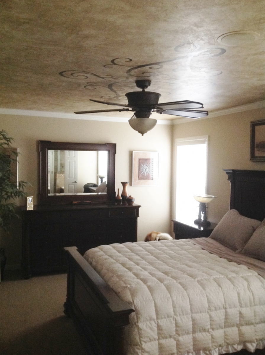 Custom bedroom ceiling design over plaster fresco.