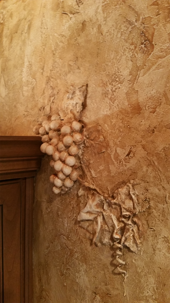 Faux Chiseled Grape Motif- added around the Bourbon and Wine Cabinet