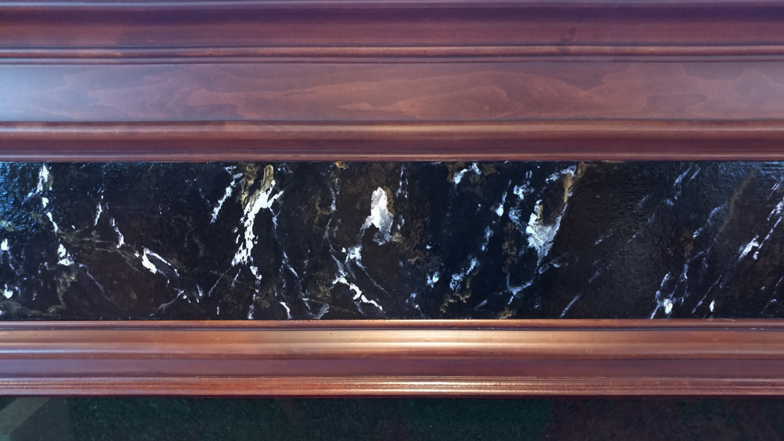 wood-grain mantel and faux marble insert.