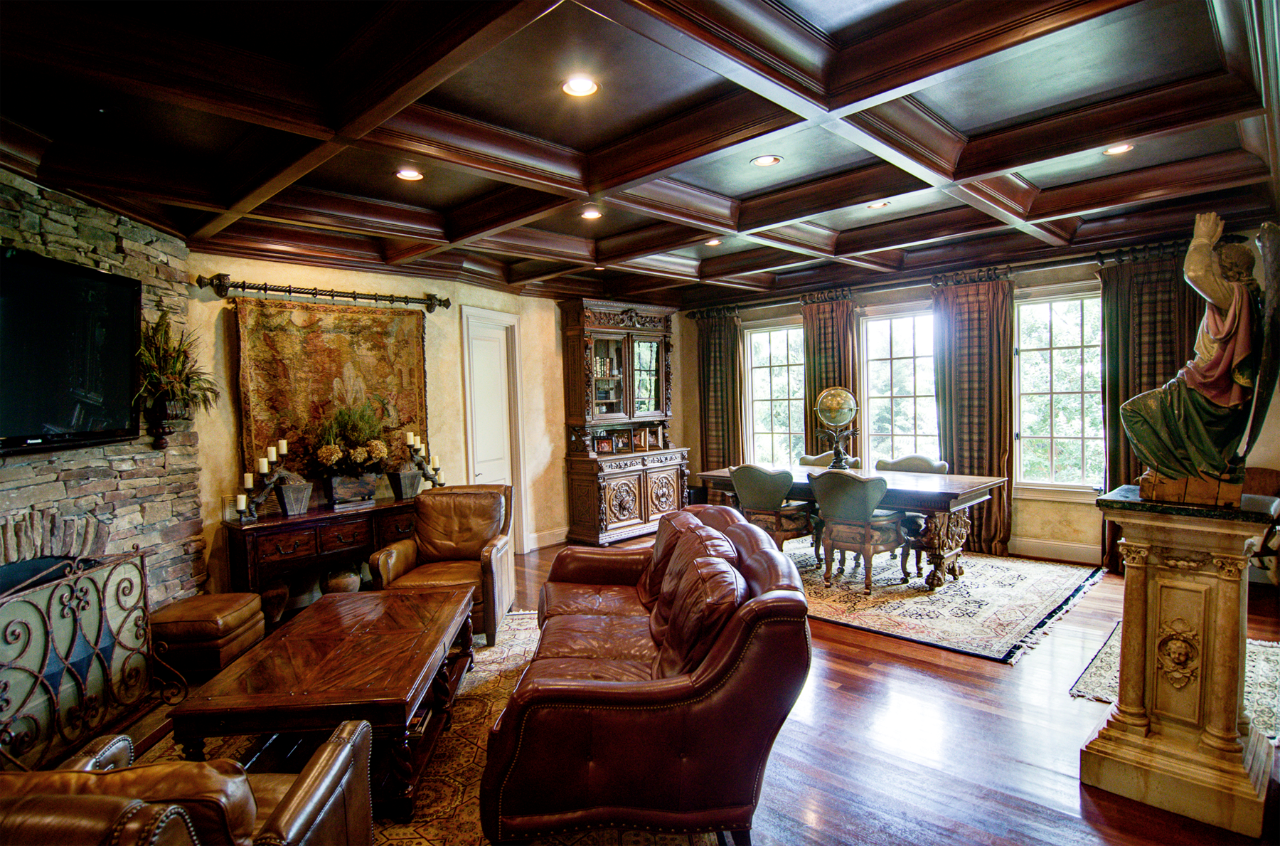 Wood grained coffer ceiling with faux metal inserts and Tuscan colored plaster walls.