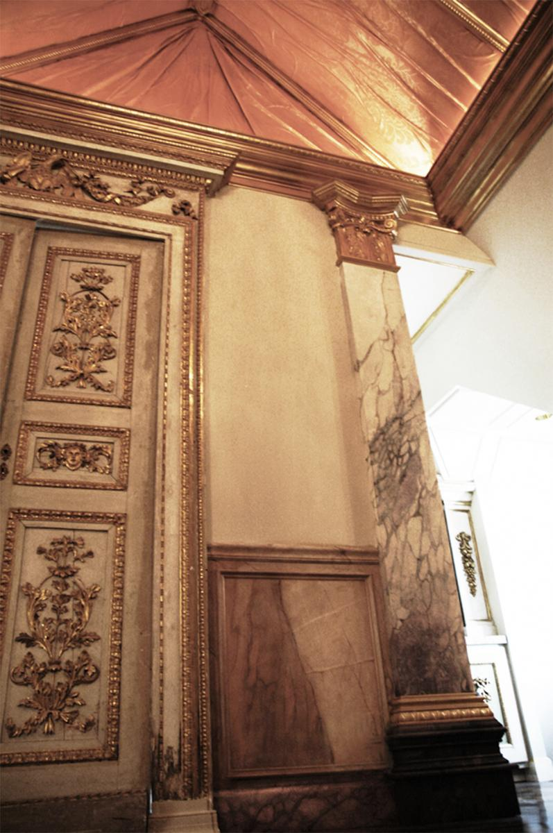 Private Client - Faux Classico marble columns with Russo marble bases, wood grained wainscot, faux wood grained inlay flooring, gold leaf millwork trim and painted folding faux copper ceiling - side view