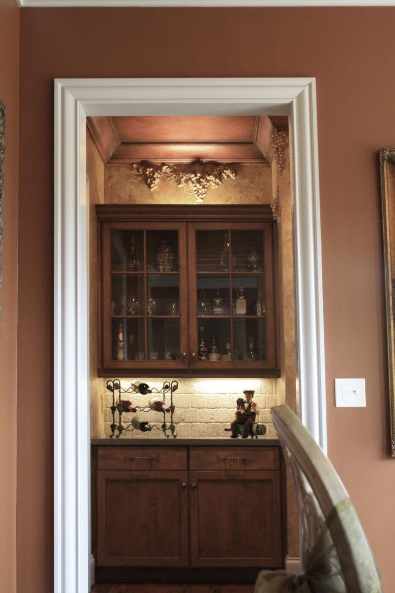 Faux Décor's sculpted grapes and Tuscany plastered walls and faux copper ceiling for this Brentwood customer's wine room.