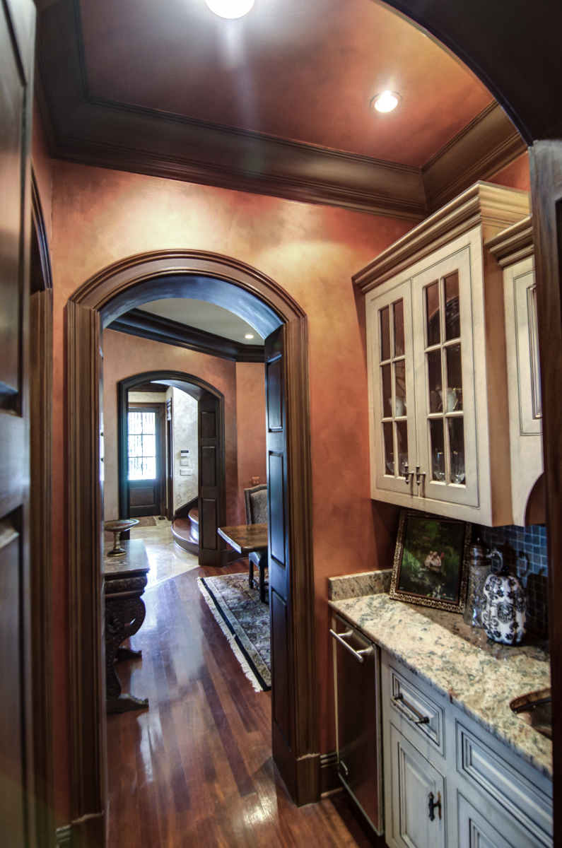 Butler's pantry –metallic glazed walls and ceiling and wood glazed trim.