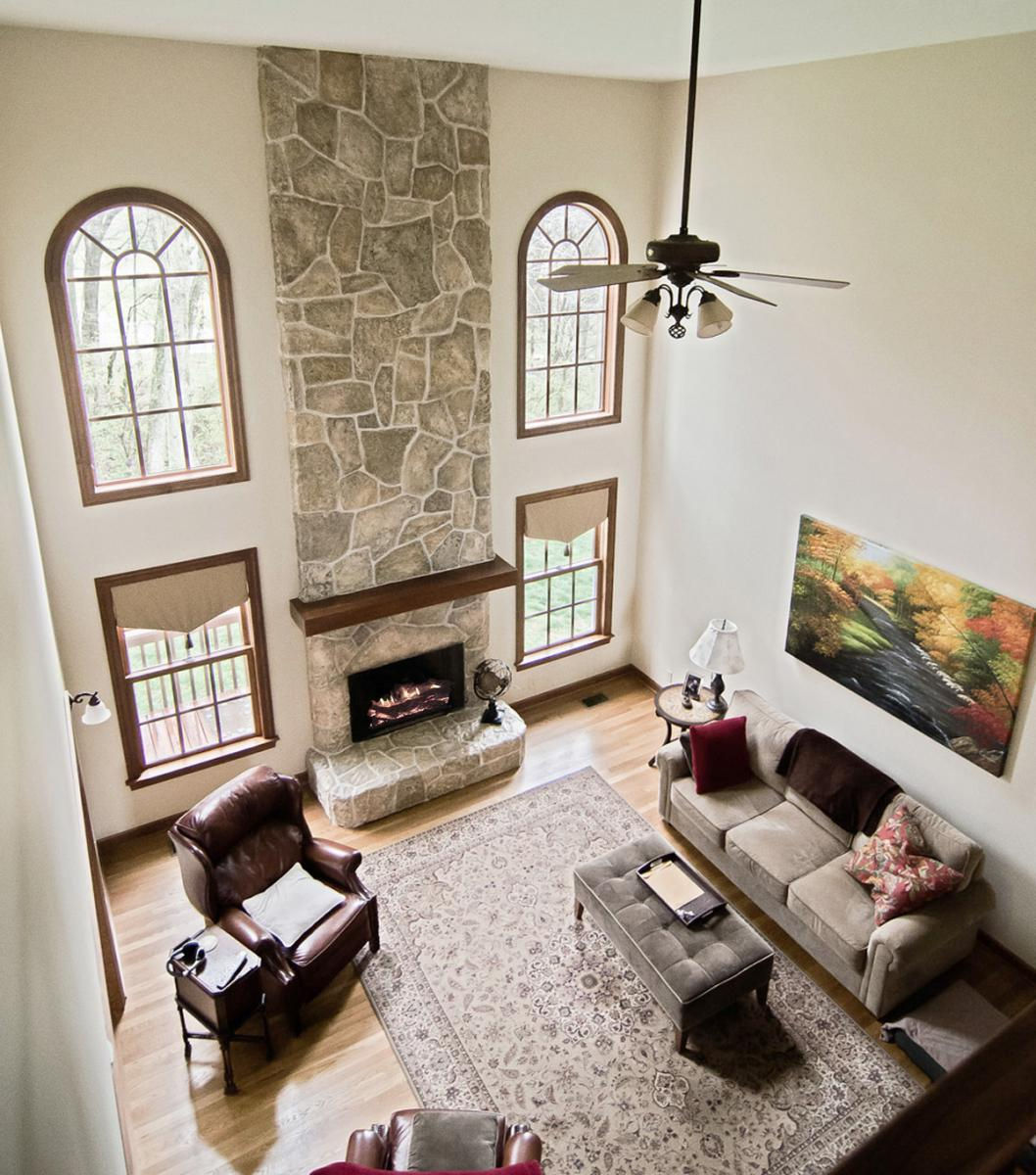 Faux plaster was used to create a complete new stone configuration. Then – custom colored glazes where applied to give this fireplace makeover that authentic look and feel.