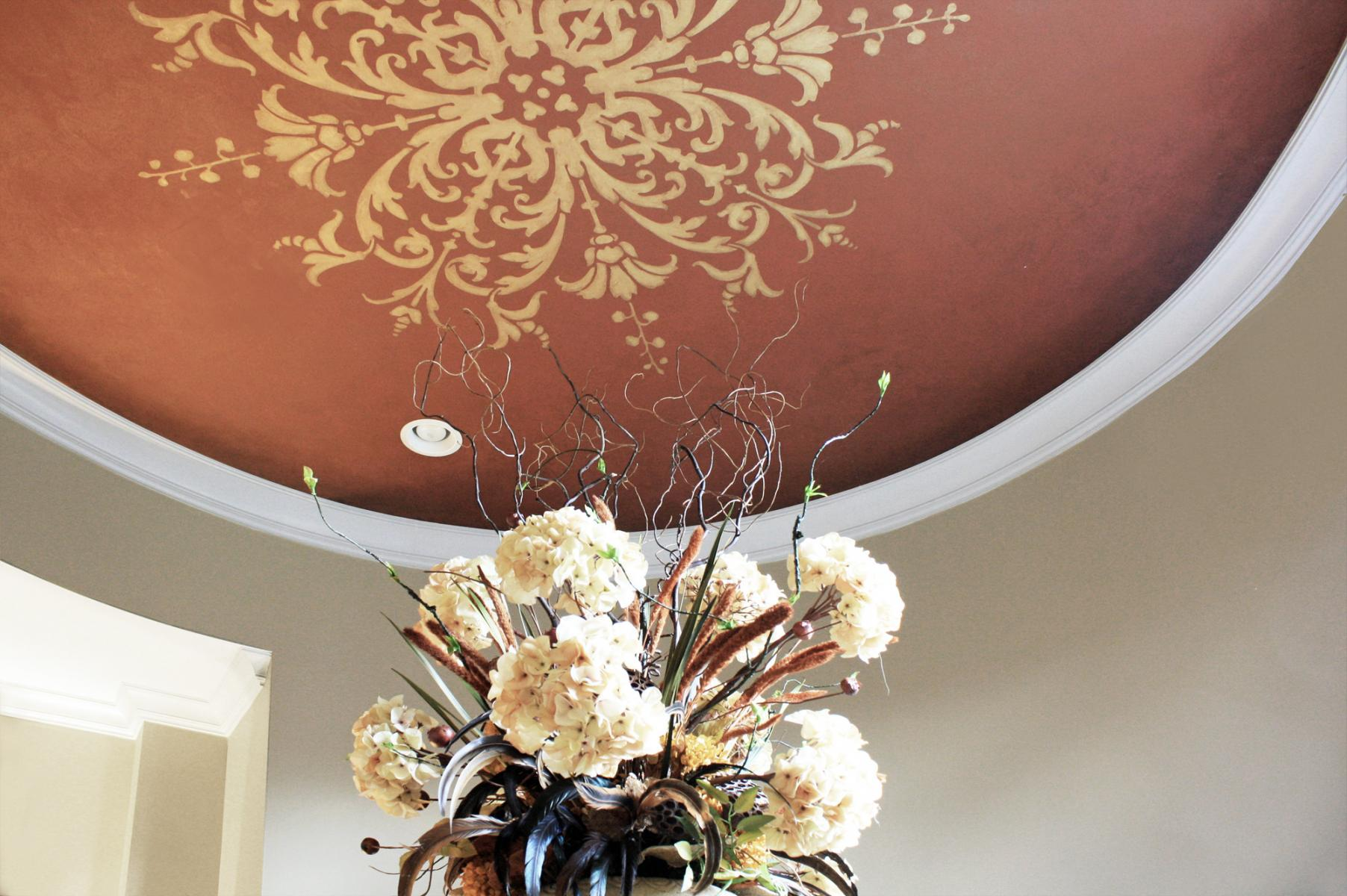 Gold ceiling design with a warm over-glaze and stained edges