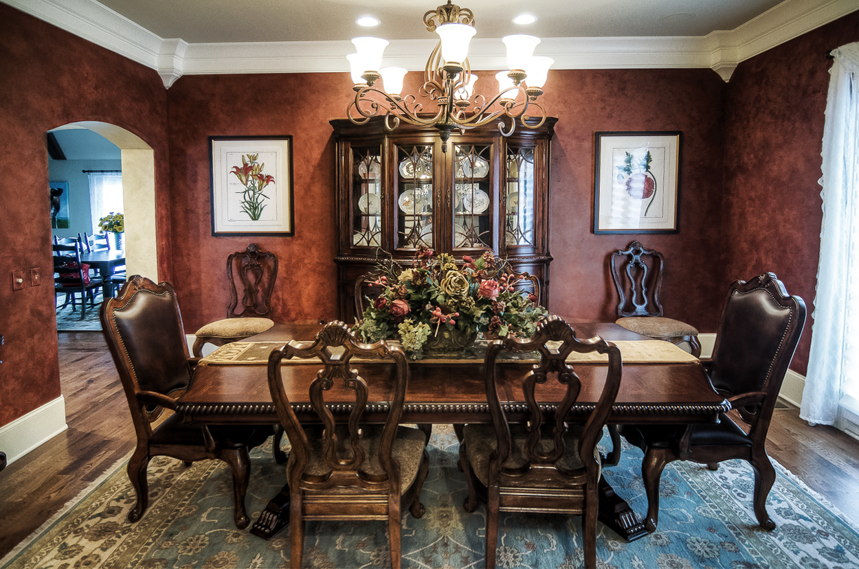 Shimmering custom colored Lusterstone dining room walls and French tinted plaster entryway.