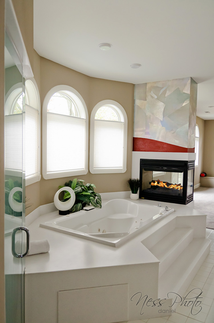 Modern look of holographic foil and ruby red burnished Venetian plaster wall design master bedroom and bath.