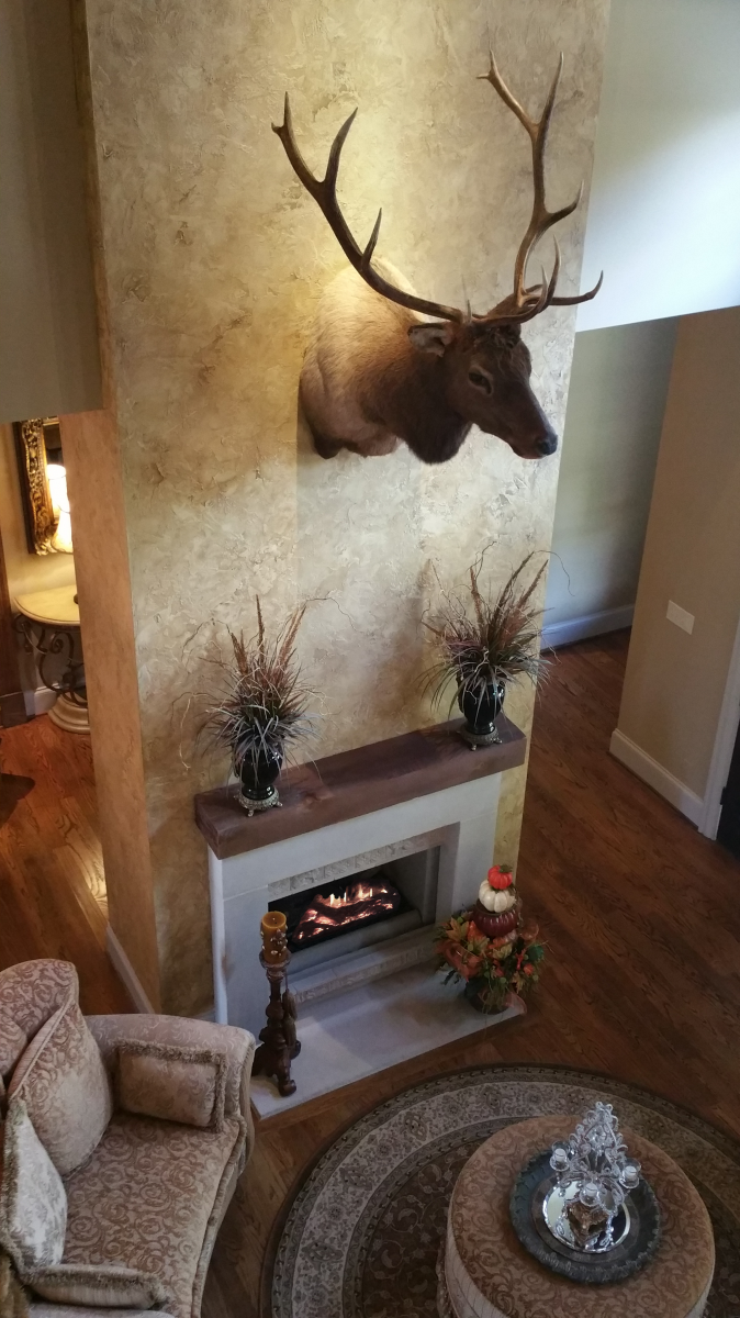 Custom great room wall color with a rustic faux plaster feature wall.