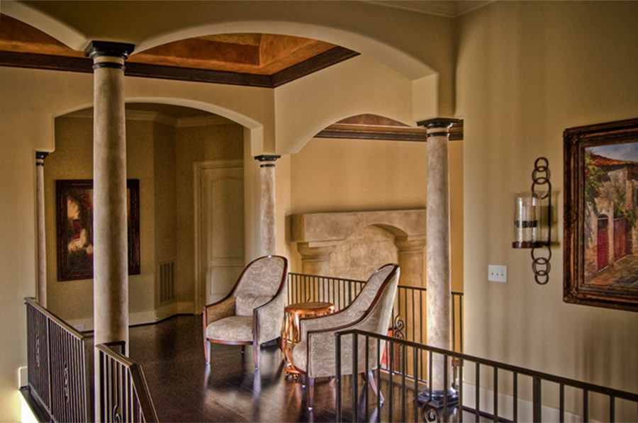 Faux stone columns and ceiling mural.