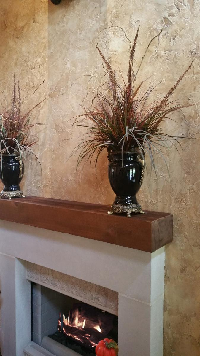 Up close fireplace custom colored plaster design.
