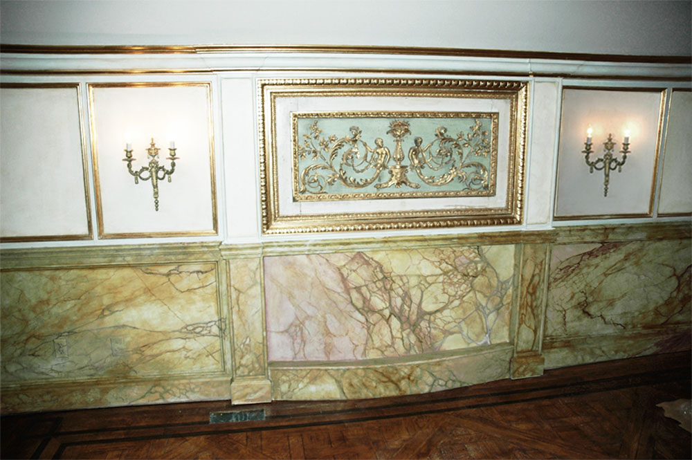 Faux marble wainscot, faux wood grained floor inlay and gold leaf mill-work trim from Andrew Bruckman.