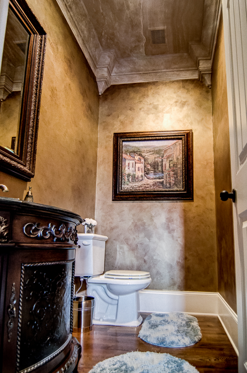 Powder room makeover - Bronze and gold metallic walls with a faux travertine ceiling cap.