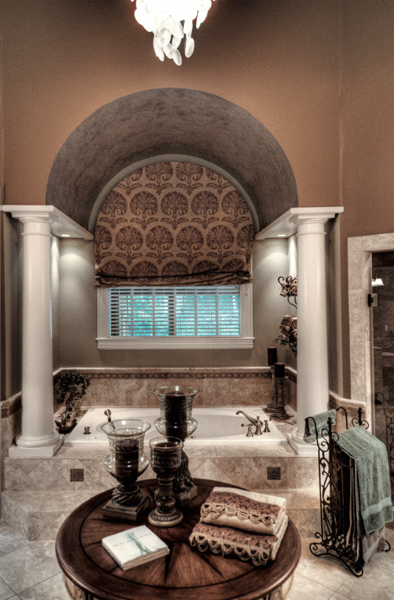 A metallic ceiling and accent colored walls make this Franklin, TN customer's master bath the perfect spa retreat.