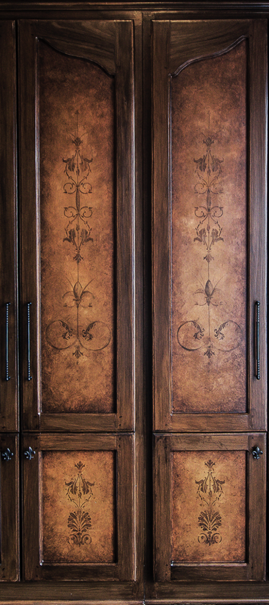 Custom hand painted built-in wood graining and mural door faces.