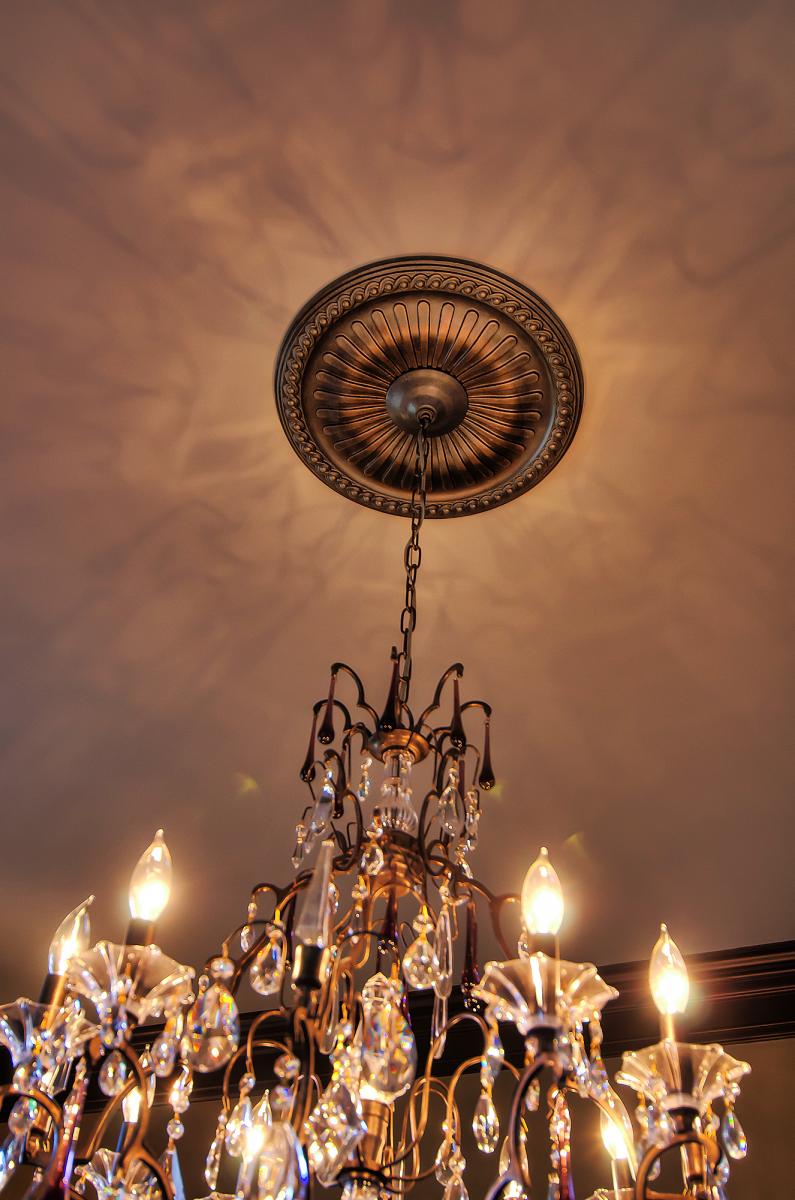 Faux metal ceiling medallion and tinted ceiling