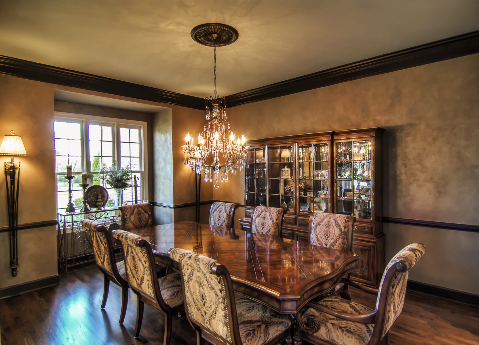 Custom blended Lusterstone for the wall finish and metallic bronze wood trim was used to achieve this elegant Franklin, TN customer's dining room makeover.