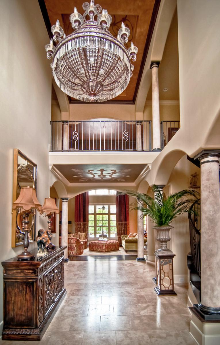 Faux stone plaster columns, metallic bronze capitals and base caps the right wall color paired with a 3D scroll relief ceiling mural. Just Beautiful!