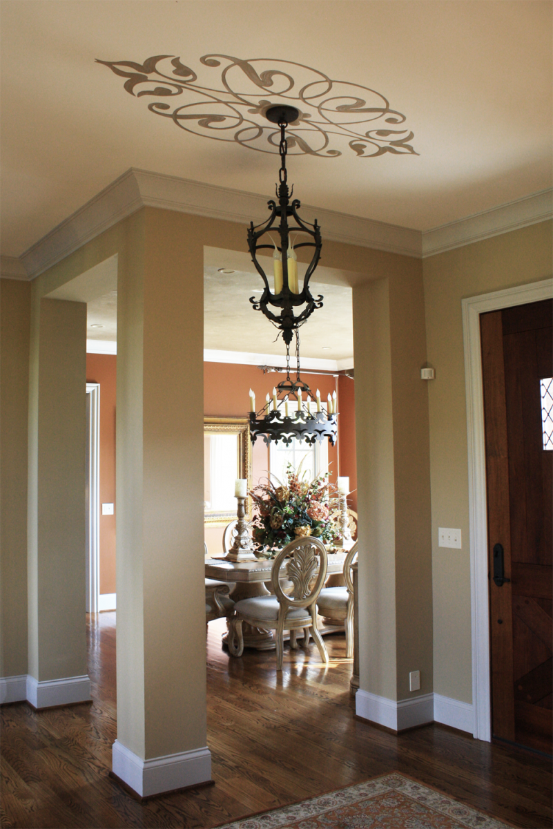 Beautiful custom colored walls in this Brentwood customer's entry and dining room with ceiling designs