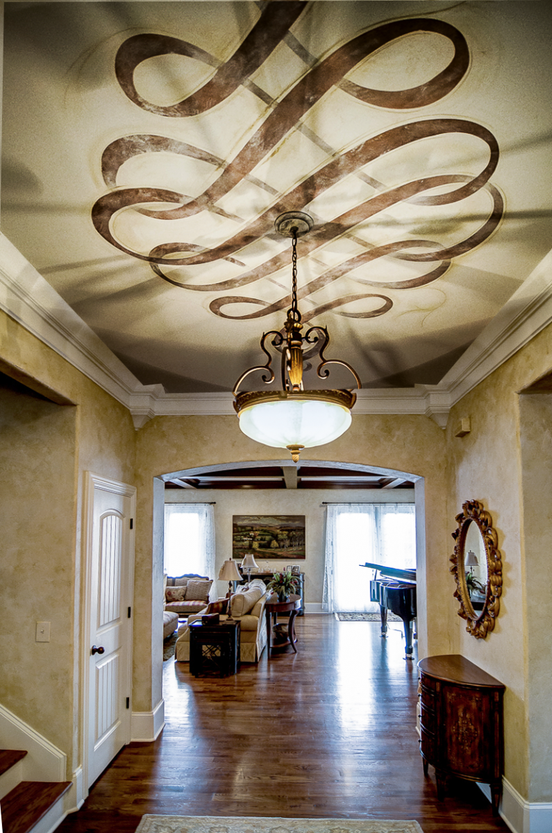European plaster walls with a hand painted metallic Modello ceiling scroll fresco.