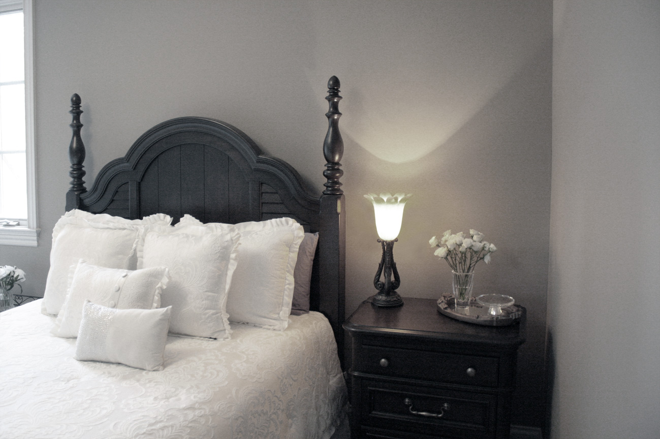 Stylish guest bedroom with custom coordinated color palate and painted professionally by Faux Décor.