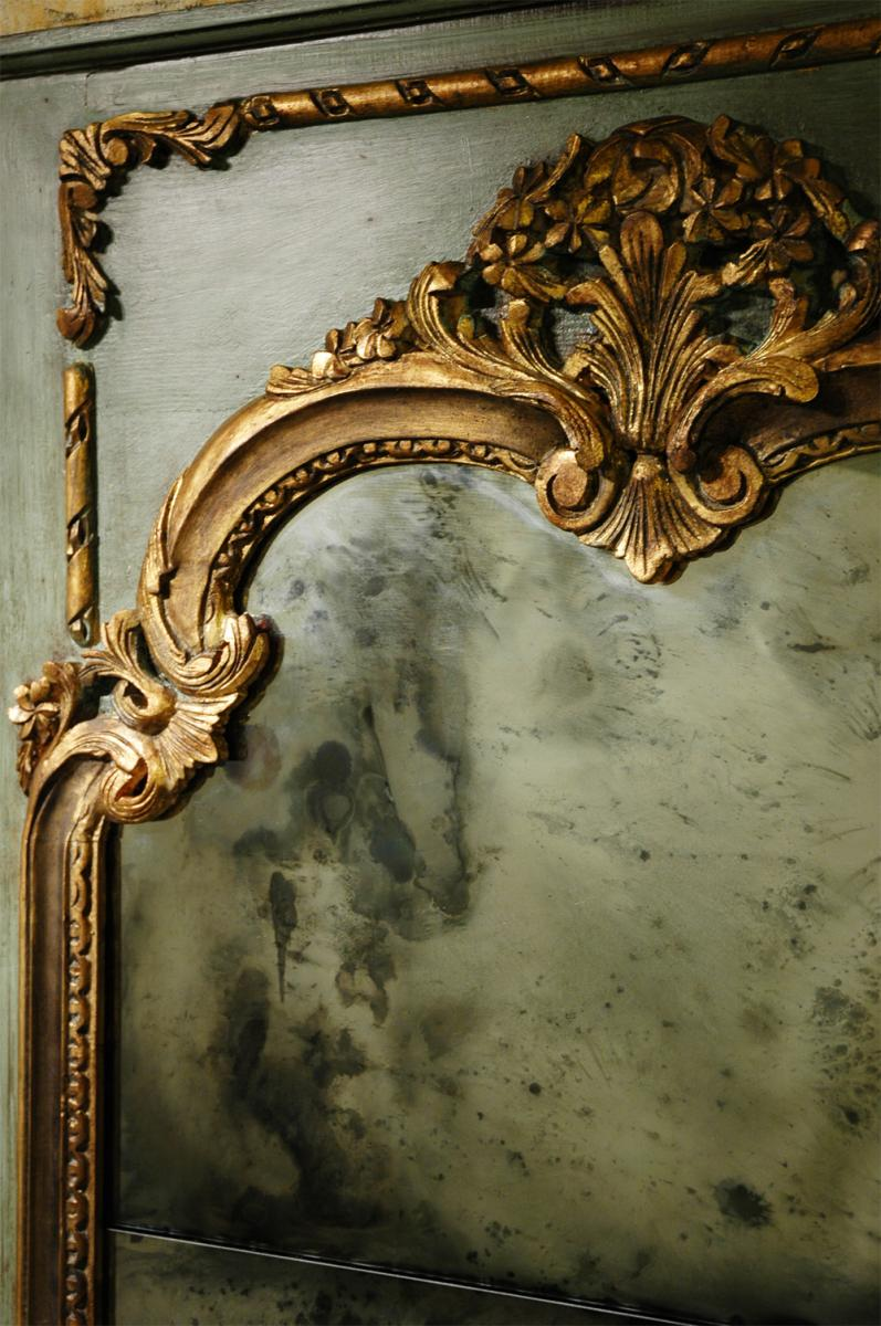 Faux antiquing on mirror glass with gold leafing on mirror frame trim.