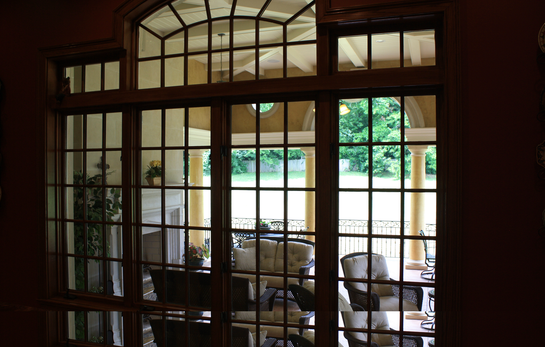 Custom designed loggia:  Venetian plaster columns with faux stone capitals and base and upper wall O'villa plaster finish.