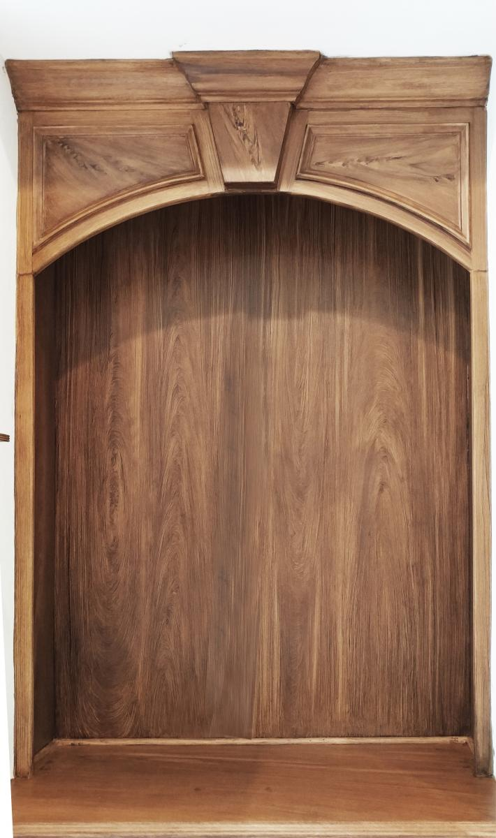 faux walnut wood grain on fireplace mantel